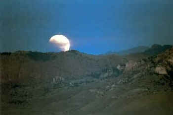 Lunar Eclipse over Sheep Mountain, west of Cody, Wyoming on July 28, 1999